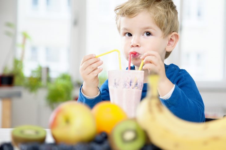 Toddler enjoying Fruit Shake Smoothie