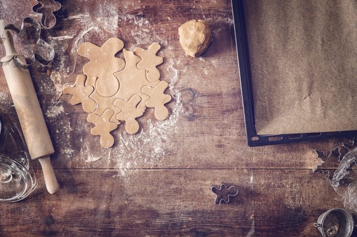 Preparing gingerbread man Christmas Cookies in domestic kitchen
