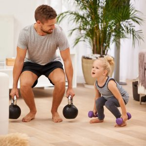 Full length shot of a father and daughter working out together